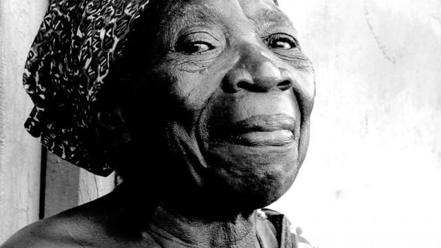 0403-Old-Woman-In-Accra-Ghana-Pride-Series-By-Lyonn-Redd-Copyright-By-LYONN-REDD-ARTIST-LyonnreddCom-A-D1503-1024x576-P1140221-Q50